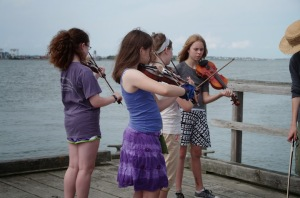 More young fiddlers on the dock